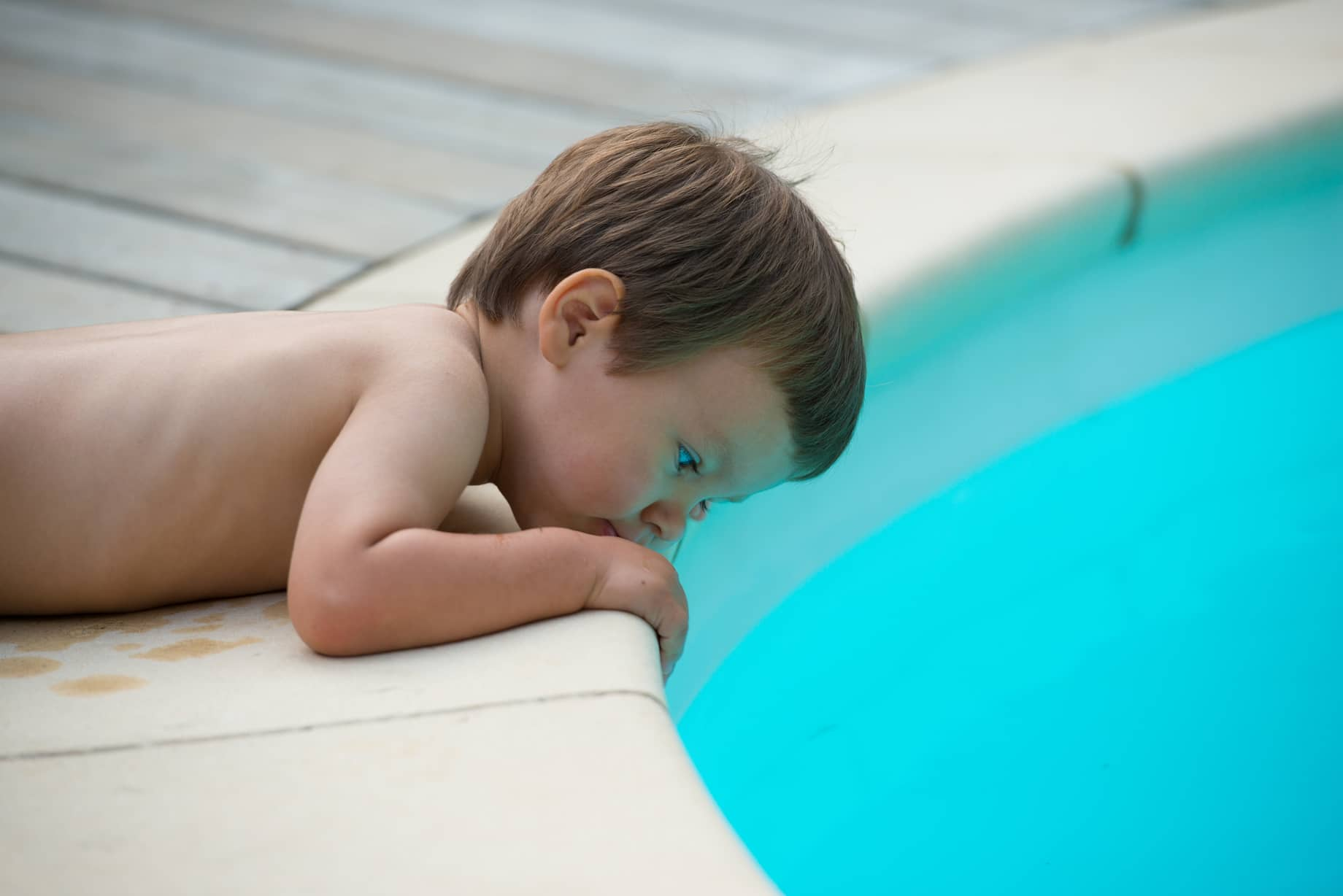 Pool Safety: Anti-Entrapment Pool Drains - Child leaning over pool